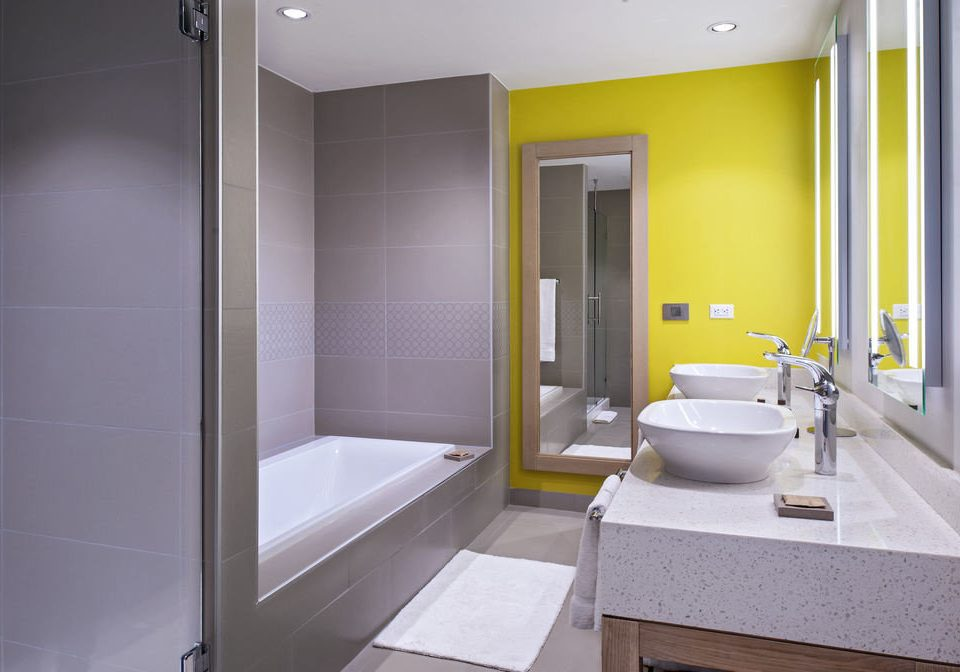 bathroom property sink scene toilet plumbing fixture home Suite flooring tub Bath bathtub tiled