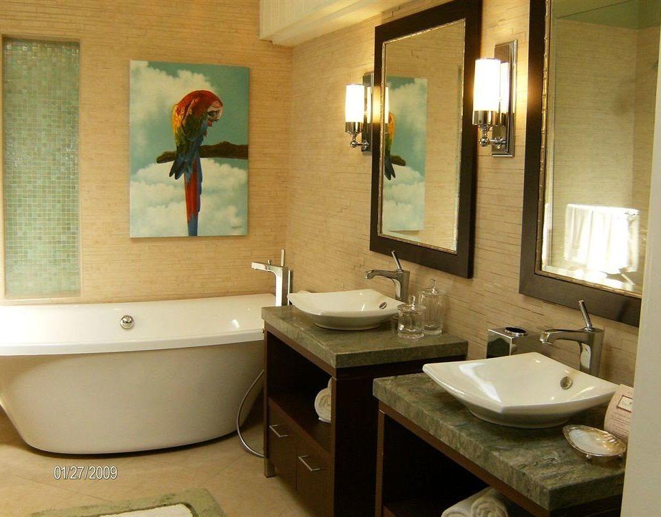 bathroom sink property home Suite cottage plumbing fixture tub Bath bathtub tan