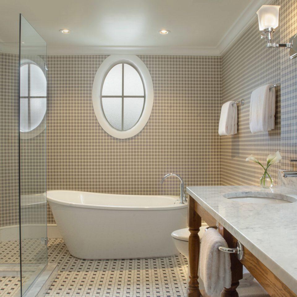 bathroom property sink bathtub plumbing fixture Suite flooring tub Bath tiled tile