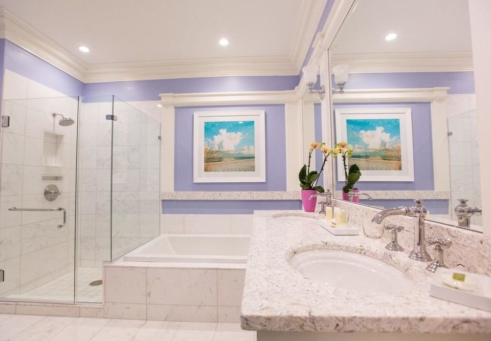 bathroom property bathtub home sink plumbing fixture swimming pool mansion living room Suite tub Bath