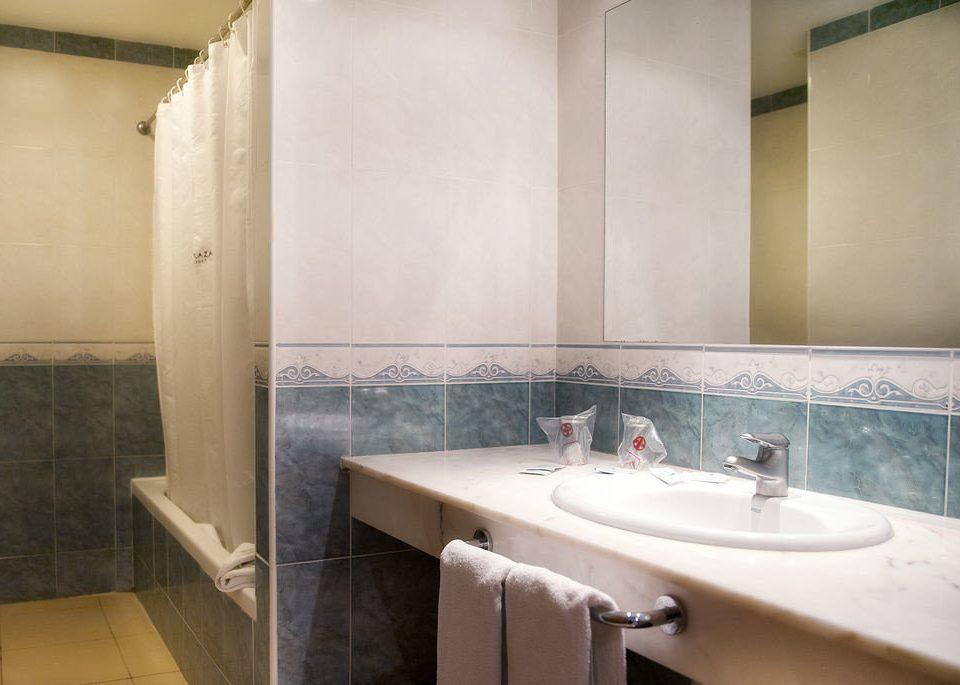 bathroom sink mirror toilet property vessel Suite swimming pool plumbing fixture bathtub tan tiled tile tub water basin Bath