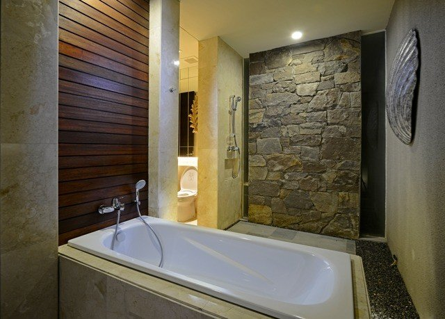 bathroom property sink swimming pool Suite plumbing fixture jacuzzi tub cottage toilet bathtub stone Bath tiled tile