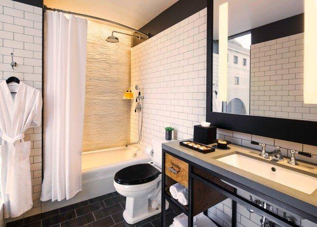 bathroom property tub bathtub home sink cottage Suite Bath tile tiled