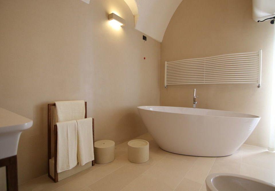 bathroom property sink bathtub bidet plumbing fixture Suite tub Bath