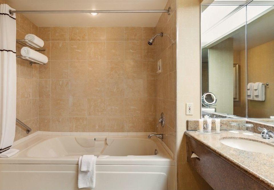 bathroom sink property toilet vessel plumbing fixture tub swimming pool Suite bathtub cottage public toilet Bath tile tan