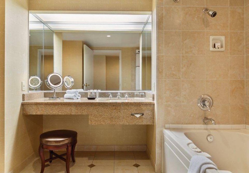 bathroom property mirror sink home Suite plumbing fixture flooring toilet tub bathtub Bath
