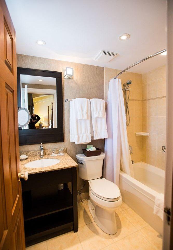 bathroom property home sink Suite cottage cabinetry tub Bath bathtub