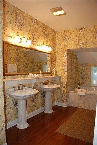 bathroom sink property mirror hardwood home cottage Suite flooring tub Bath bathtub
