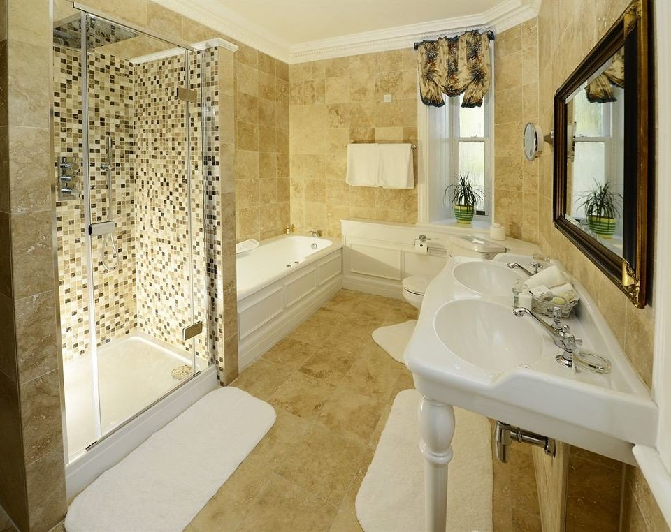 bathroom sink mirror property tub home bathtub Suite tiled flooring Bath tile plumbing fixture cottage mansion
