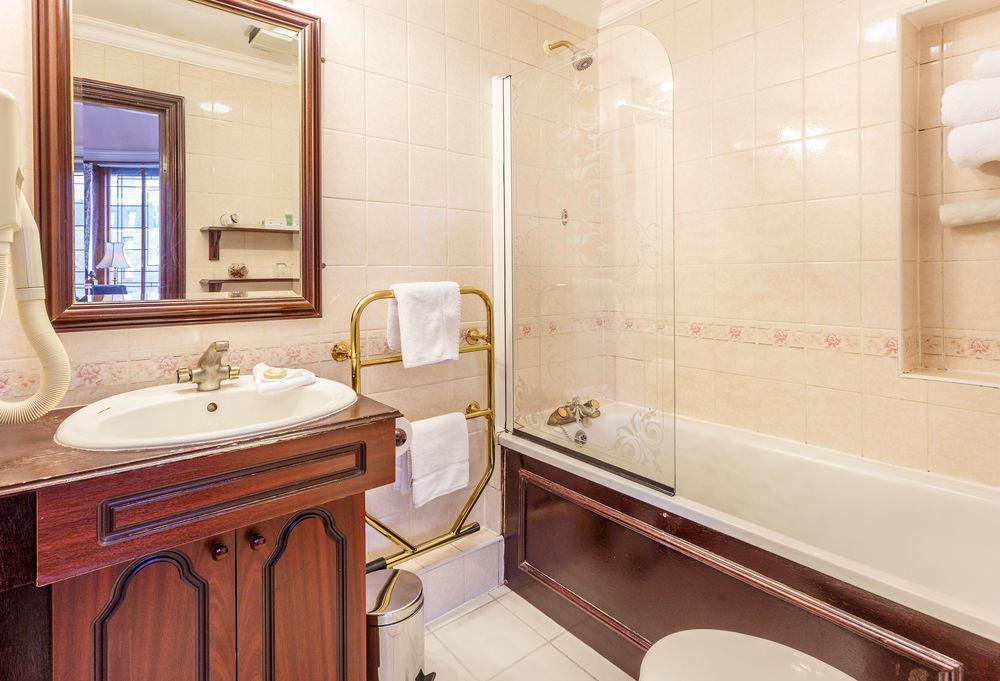 bathroom property sink Suite home tub cottage bathtub Bath tile tiled tan