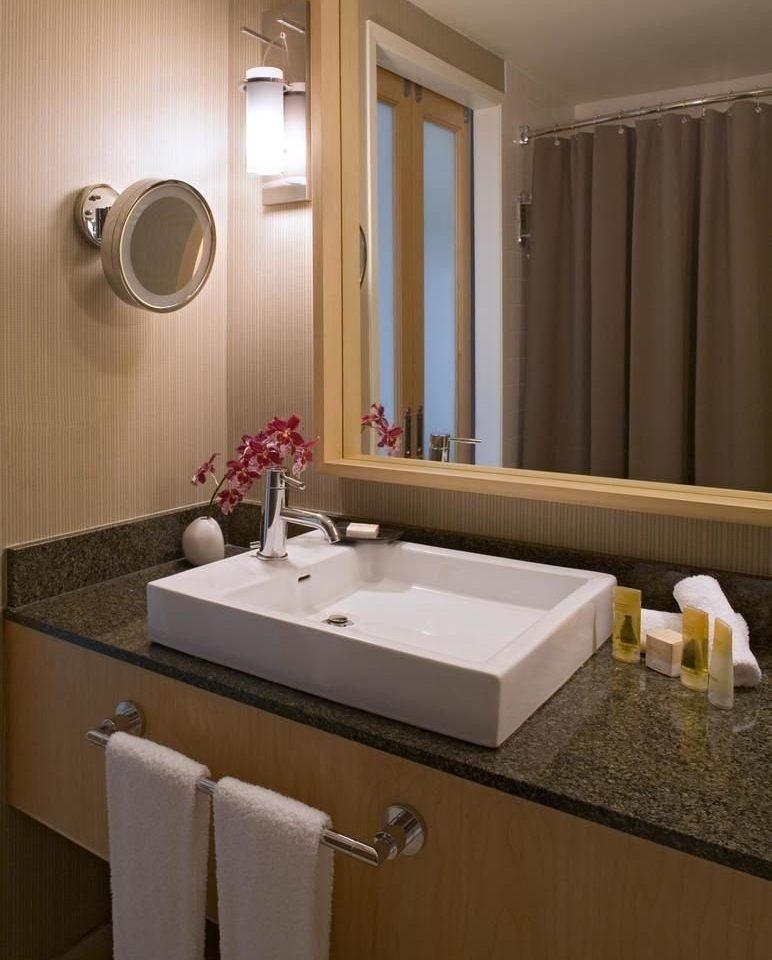 bathroom sink mirror property Suite towel tub shower bathtub double plumbing fixture long toilet Bath clean