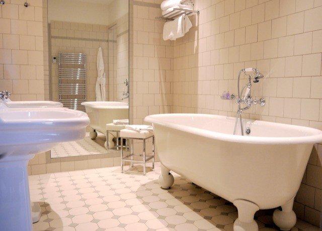 bathroom property bathtub vessel plumbing fixture tiled bidet tile toilet flooring swimming pool tub Suite Bath water basin