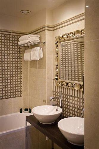 bathroom sink property shower tiled plumbing fixture Suite tub flooring tile toilet bathtub Bath