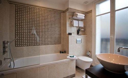 bathroom property sink tub Suite plumbing fixture flooring bathtub Bath tiled tile