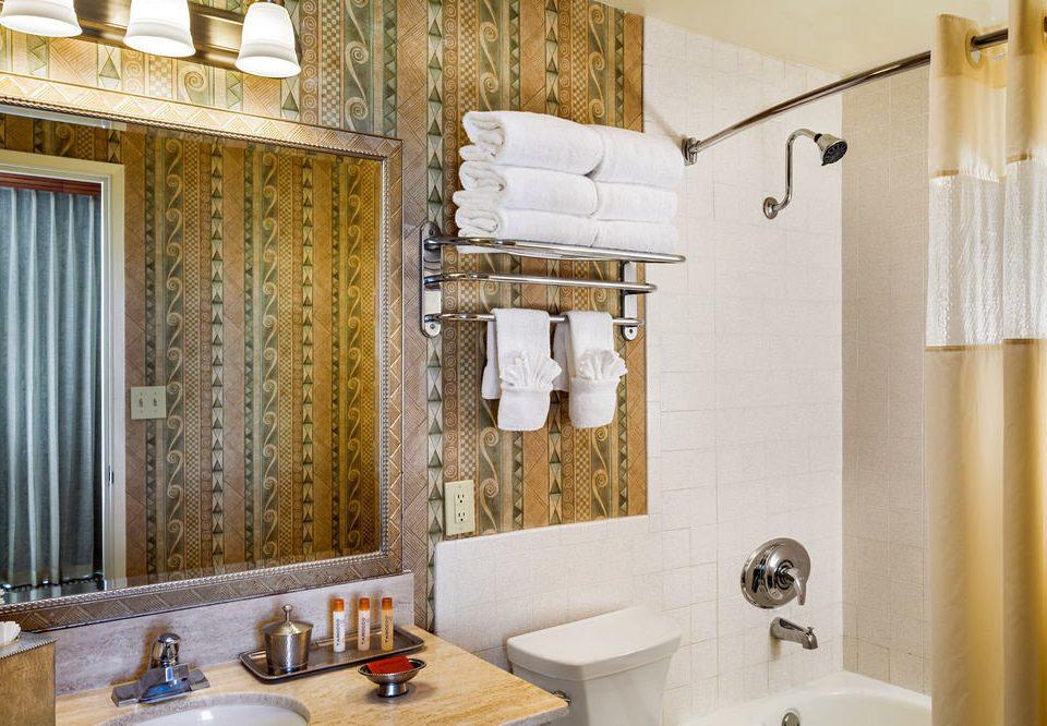 bathroom sink mirror property towel home white cottage farmhouse Suite tile tub Bath rack bathtub