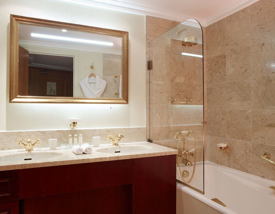 bathroom property sink home countertop cabinetry white Suite plumbing fixture flooring tub bathtub Bath tan