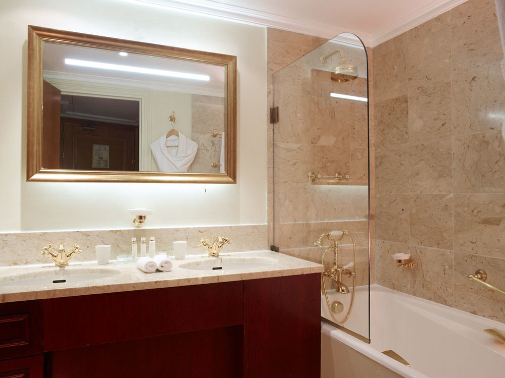 bathroom property sink home countertop cabinetry white Suite plumbing fixture flooring tub bathtub Bath tan
