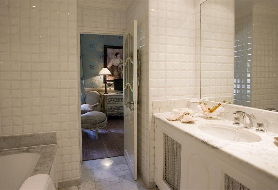 bathroom sink property tiled tile home swimming pool toilet tub bathtub plumbing fixture Suite Bath public toilet jacuzzi