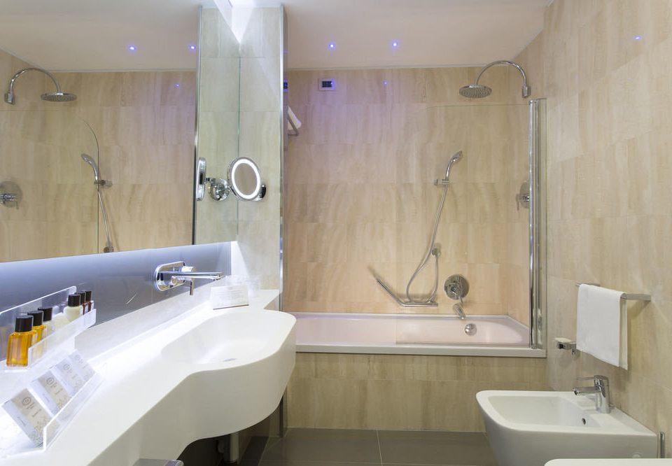 bathroom property sink toilet bathtub Suite plumbing fixture tub Bath tiled
