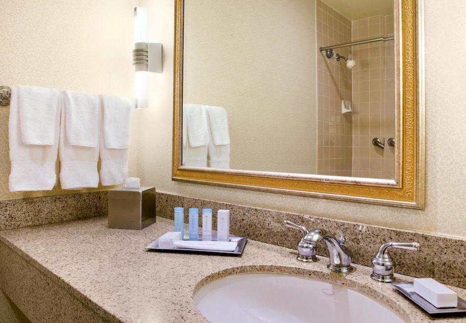 bathroom sink mirror towel property Suite flooring vanity home Bath tub clean tan bathtub