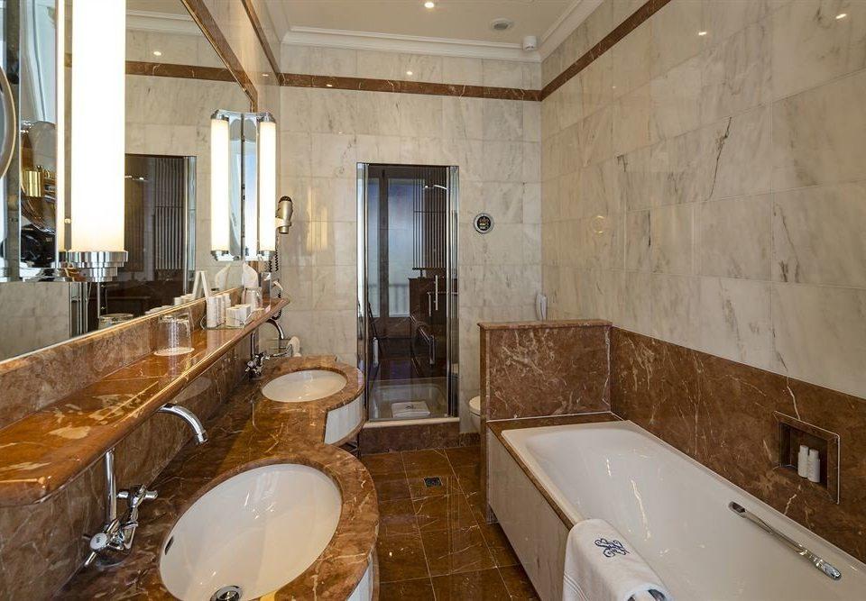 bathroom property sink toilet swimming pool home tub cottage Suite flooring bathtub Bath tiled