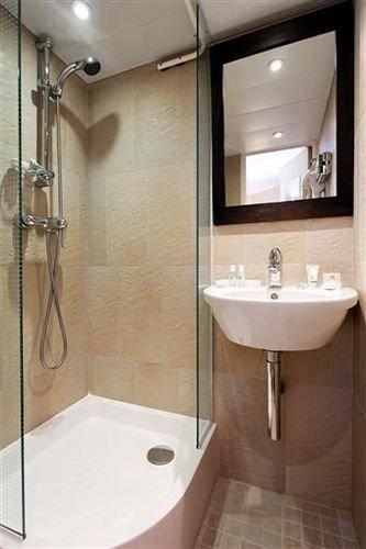 bathroom sink property scene plumbing fixture white bidet toilet Suite tile tiled tub bathtub Bath