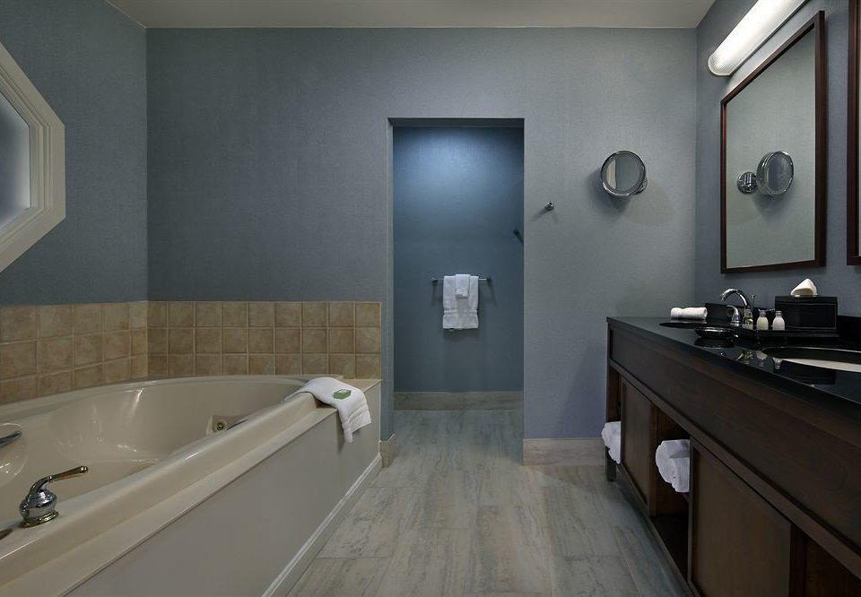 bathroom sink property tub bathtub Suite flooring plumbing fixture Bath tan