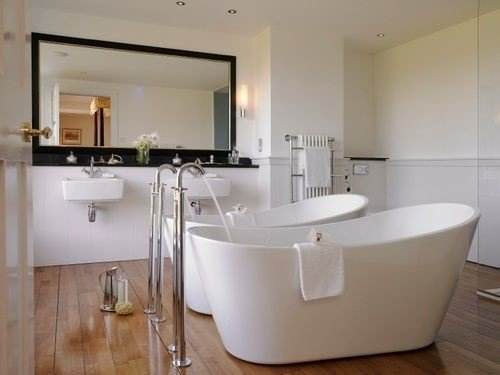 bathroom property bathtub bidet sink plumbing fixture Suite toilet tub Bath