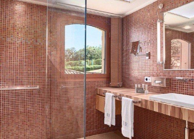 bathroom brick property tiled tile sink Suite flooring tub Bath