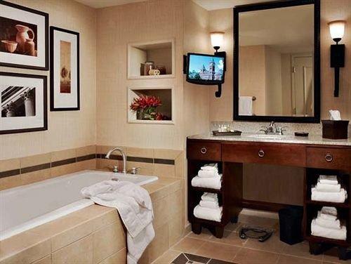 bathroom property sink home cottage cabinetry Suite mansion living room tub Bath
