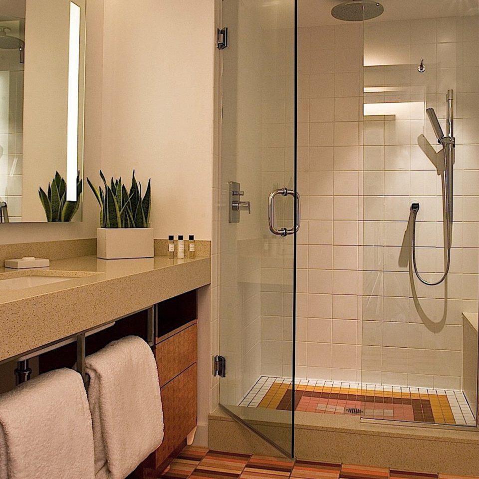 bathroom property mirror sink towel home Suite cabinetry flooring plumbing fixture tile rack Bath tiled
