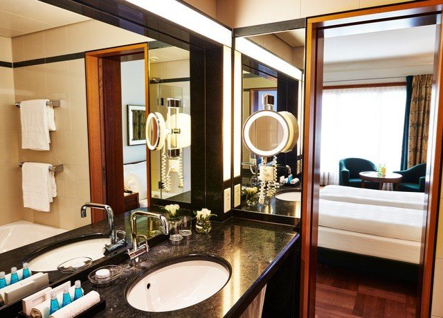 bathroom sink mirror property Suite home yacht condominium vehicle toilet counter living room cabinetry tub Bath