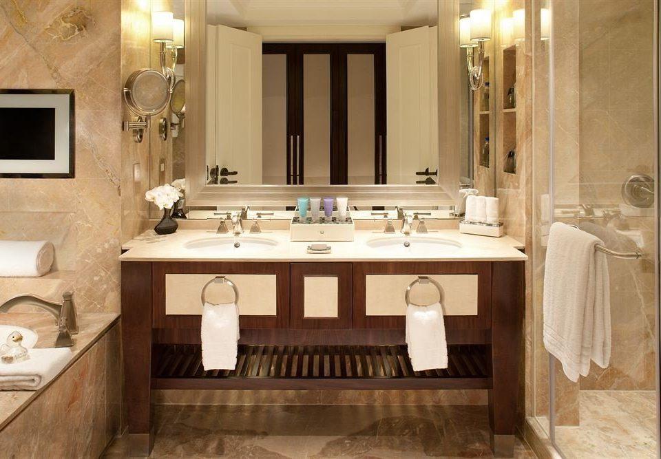 bathroom property countertop sink cuisine classique hardwood home cabinetry mansion flooring material Suite tub Bath