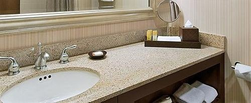 bathroom sink mirror property countertop counter hardwood flooring material Suite clean Bath