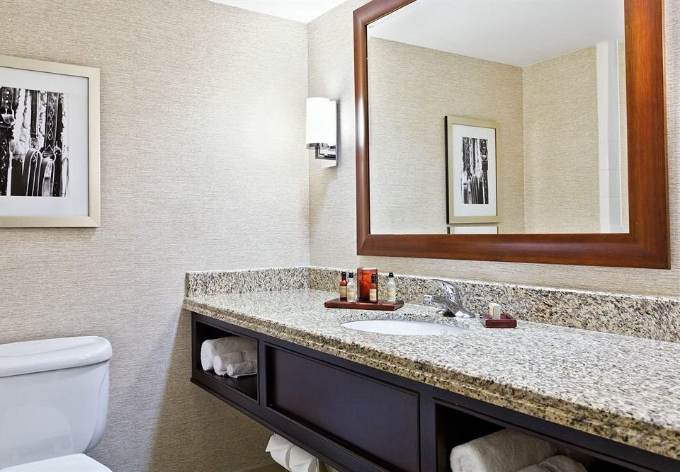 bathroom sink property mirror home Suite towel cottage flooring countertop counter vanity clean tan Bath