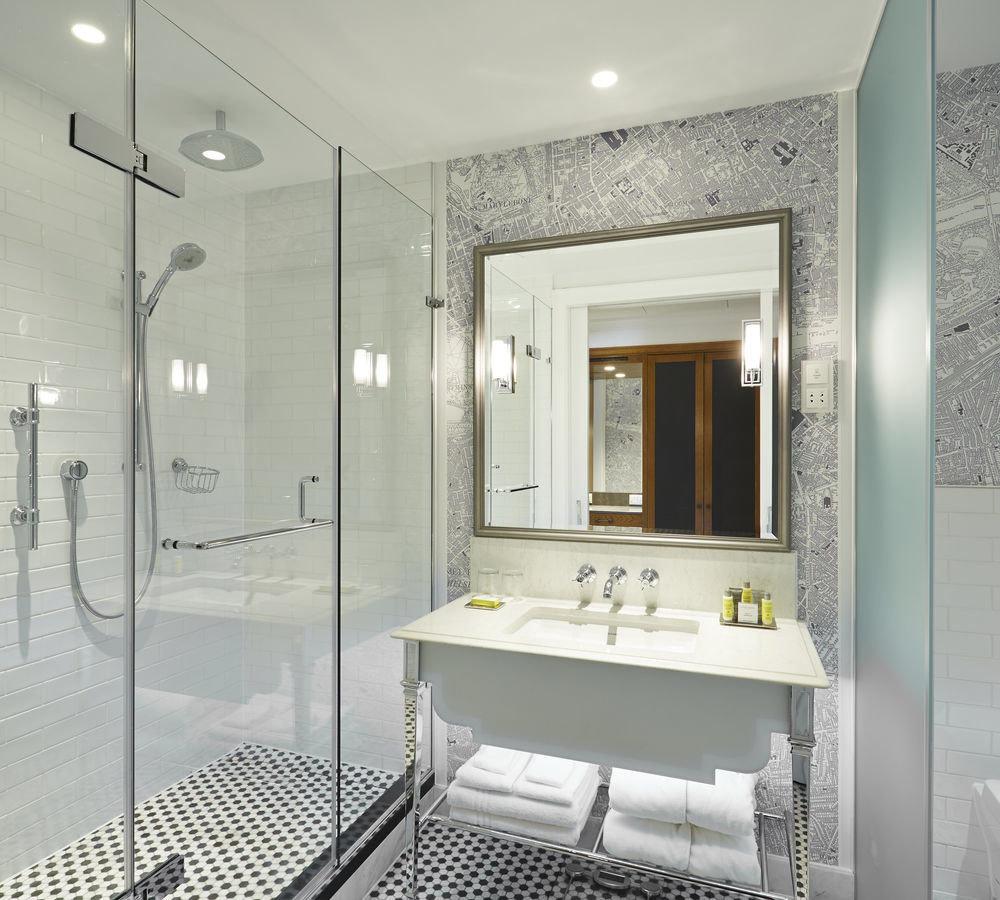 bathroom property mirror shower white condominium plumbing fixture flooring Suite Bath
