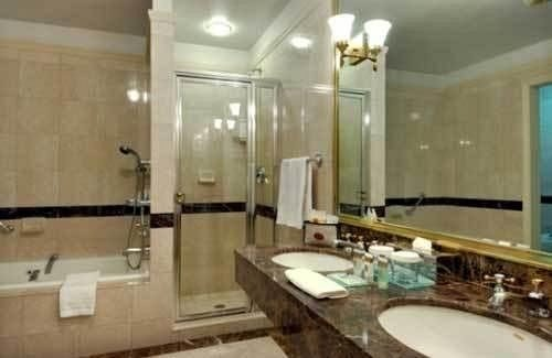 Bath bathroom sink mirror property swimming pool mansion Suite condominium toilet