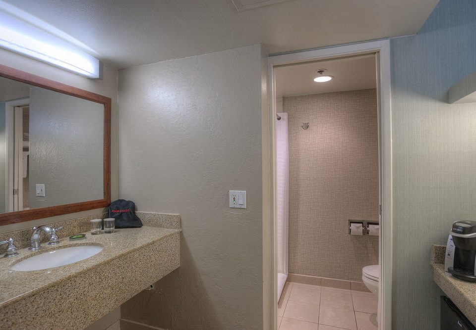 bathroom mirror sink property toilet home vanity Suite public toilet plumbing fixture cottage tub tan rack tile Bath