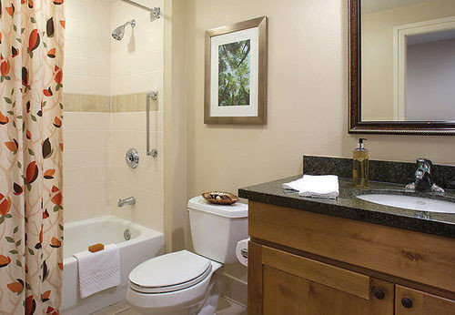 bathroom sink property curtain toilet shower home cottage Suite tub Bath