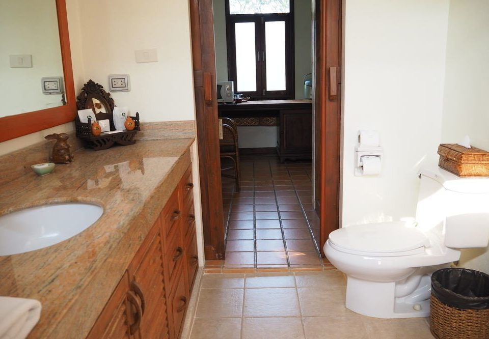 bathroom property toilet sink home cottage hardwood flooring Suite tub Bath tile tiled