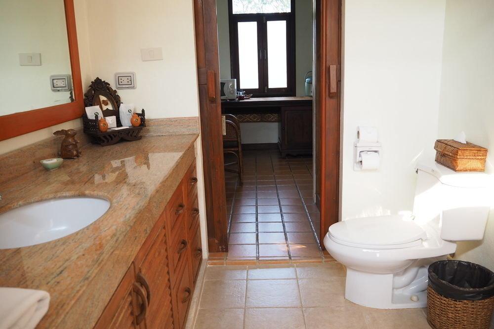 bathroom property toilet sink home cottage hardwood flooring Suite tub Bath tile tiled