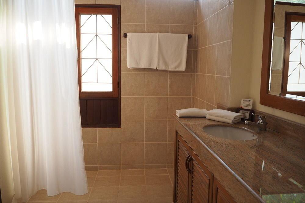 bathroom property curtain house sink home cottage Suite flooring tub Bath tiled