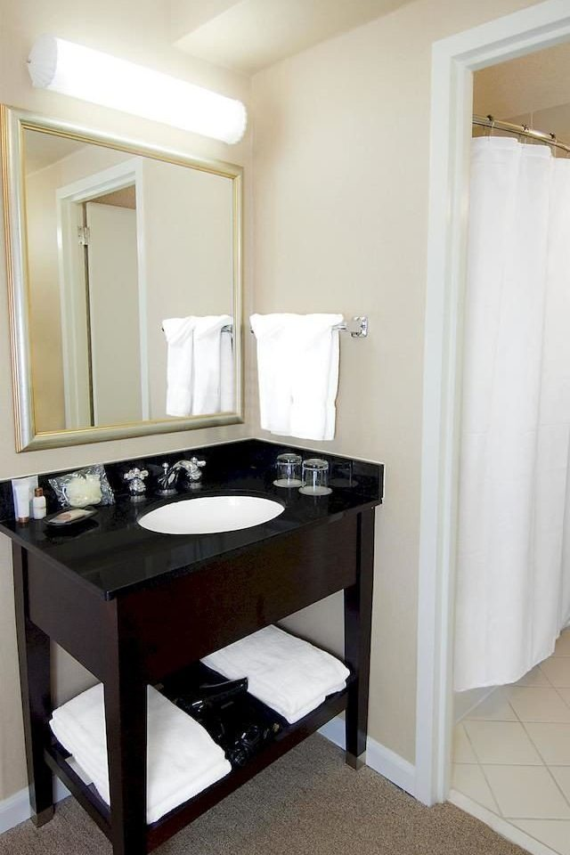 bathroom mirror property sink toilet home cottage Suite tub Bath