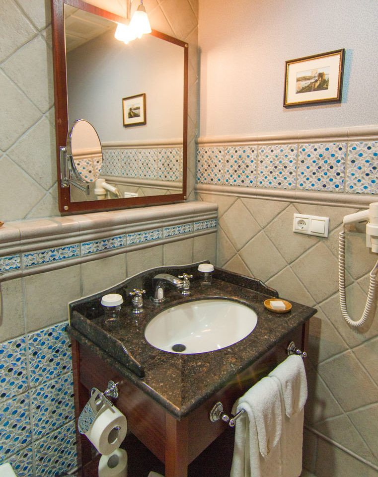 bathroom property sink swimming pool home cottage Suite plumbing fixture countertop toilet tile Bath tiled