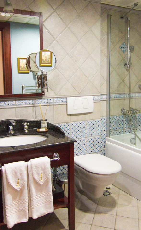bathroom sink property home cottage flooring plumbing fixture towel Suite tile rack Bath tub tiled