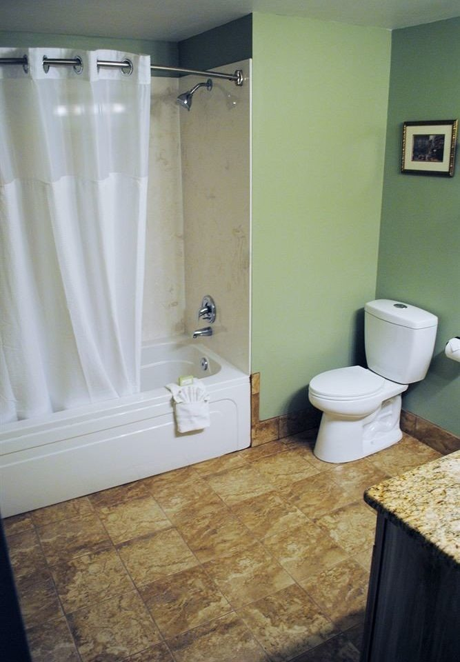 bathroom property toilet house sink plumbing fixture home white flooring cottage Suite tub Bath