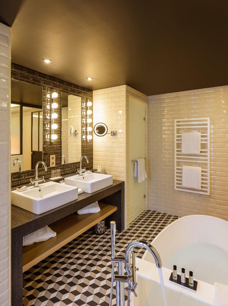 bathroom property sink counter lighting home flooring Suite tile tub Bath tiled