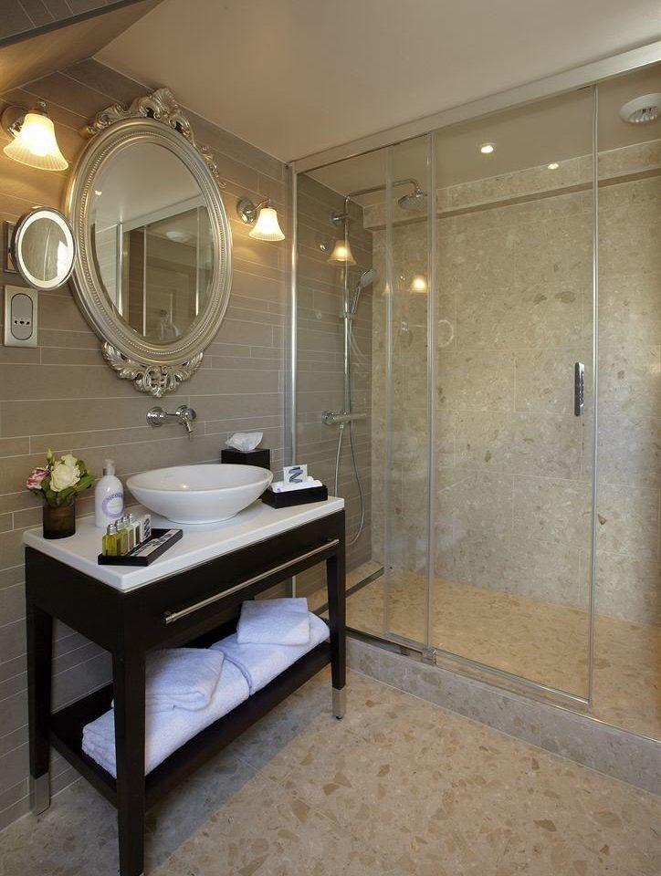 bathroom property sink home counter flooring plumbing fixture Suite Bath tiled