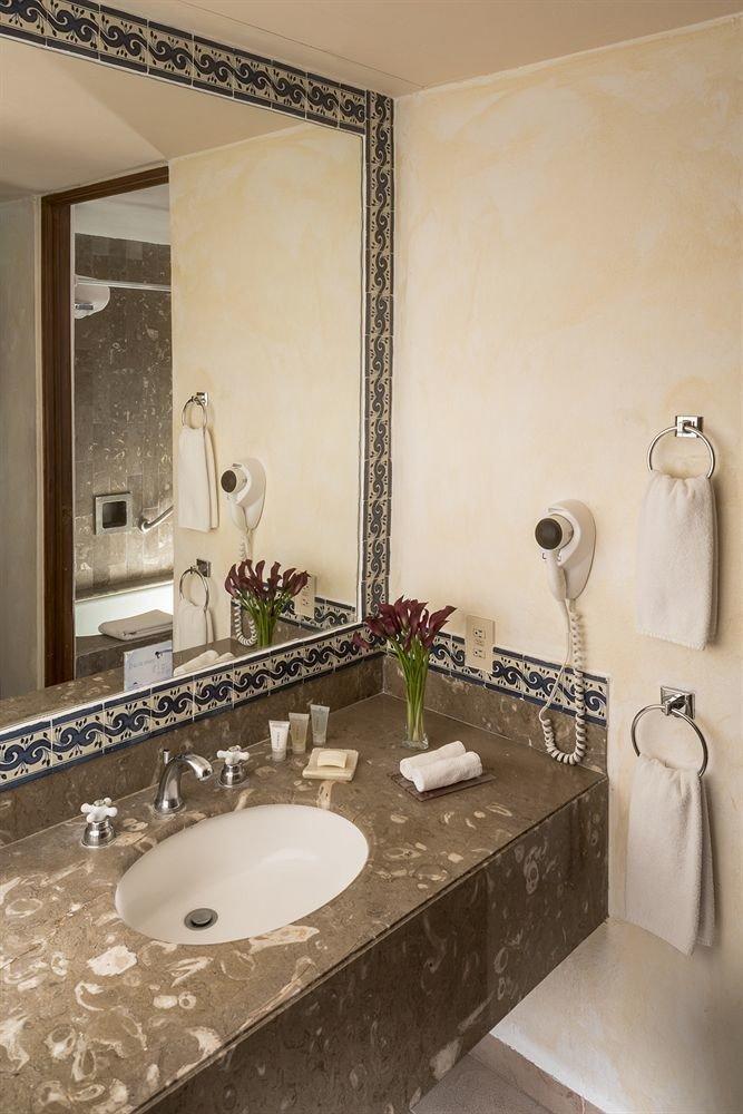 bathroom sink mirror property countertop home flooring tile counter vanity double towel Suite toilet plumbing fixture Bath