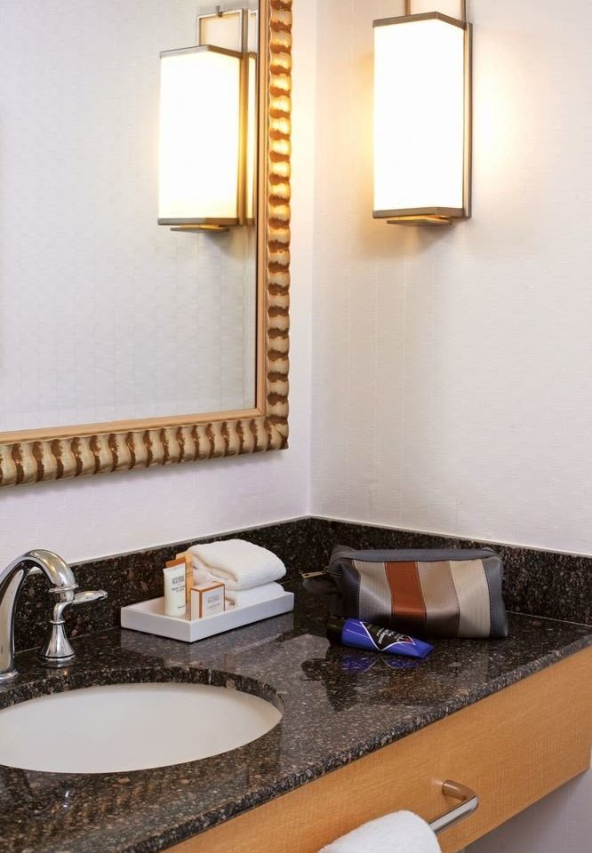 bathroom sink mirror towel counter lighting Suite flooring Bath